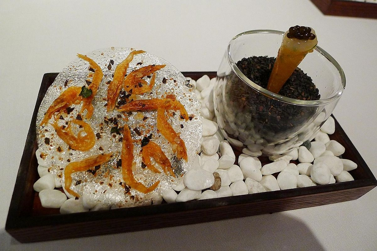 """The """"ebi two ways"""" (above) at Iggy's comes with a translucent cracker that crumbles delightfully in the mouth."""