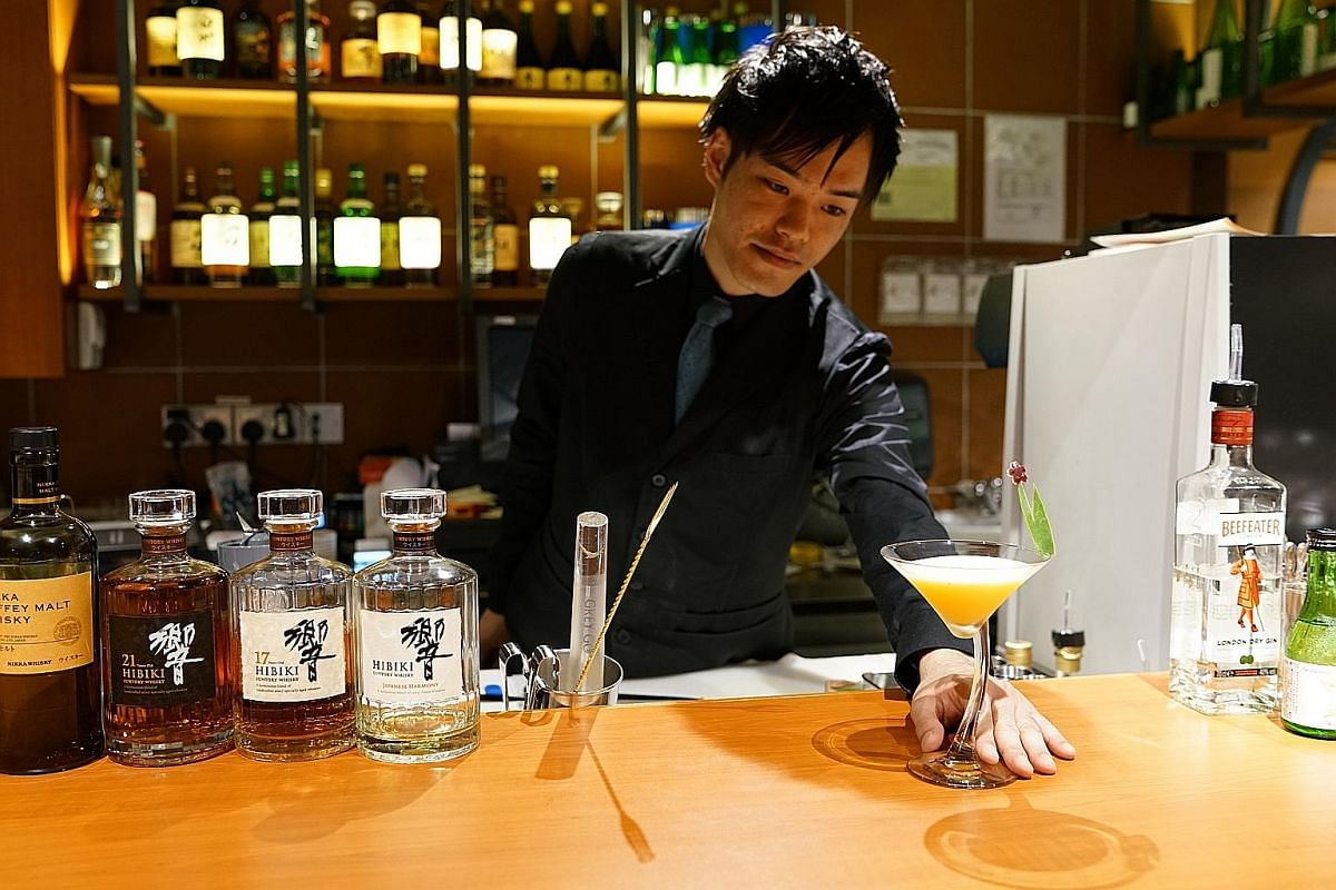 Speakeasy bar Cache's manager Shinya Koba designed the cocktails on its menu. Bar Nippon's bartender, Mr Tsuyoshi Ogoshi, with a passionfruit cocktail. Mr Hirose Norihito, general manager of Takumi Craft Beer Bar.