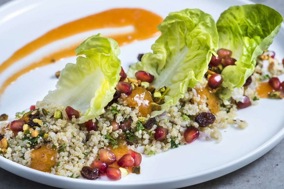 Coo Bistro Quinoa (above), with pomegranate, raisins, toasted pistachio, carrot puree and lettuce.