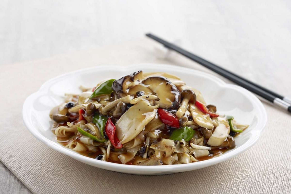 Wok-fried hor fun with wild mushrooms in black bean sauce from Canton Paradise.