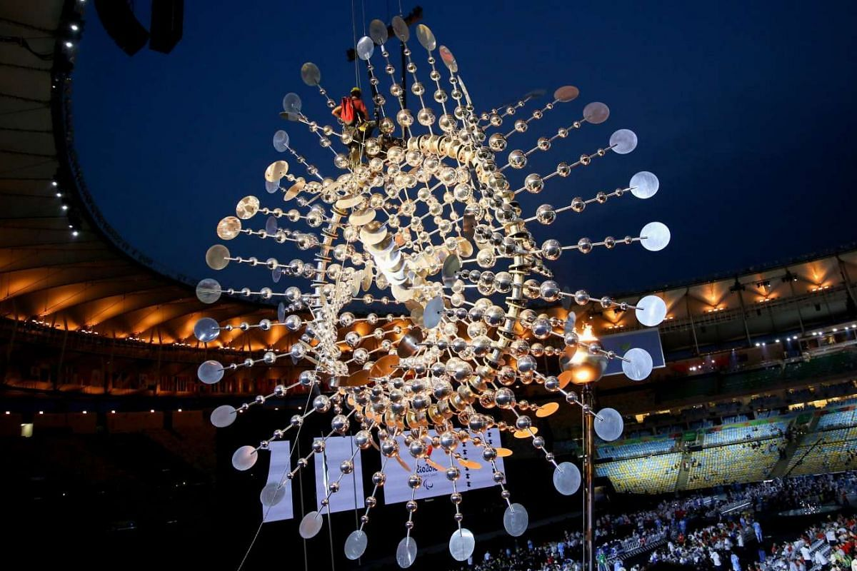 A climber works behind the flame of the Paralympics prior to the closing ceremony of the Rio 2016 Paralympic Games at the Maracana Stadium in Rio de Janeiro, Brazil on Sept 18, 2016.
