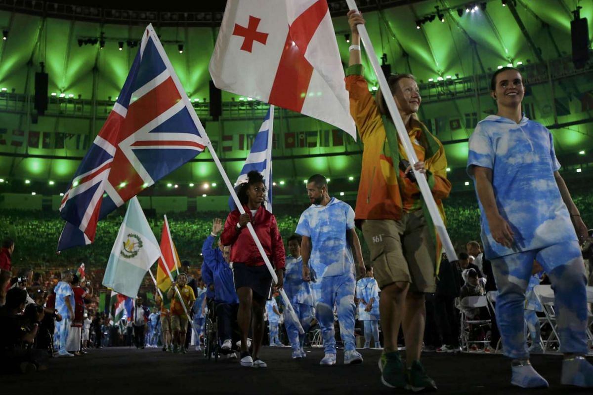 Flag-bearers hold their national flags as they take part in the closing ceremony of the Rio 2016 Paralympic Games at the Maracana Stadium in Rio de Janeiro, Brazil on Sept 18, 2016.