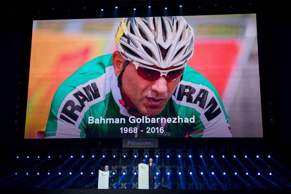 A moment of silence is observed in honour of Bahman Golbarnezhad of Iran who passed away following a crash during the C4 Cycling Road Race, during the closing ceremony of the Rio 2016 Paralympic Games at the Maracana Stadium in Rio de Janeiro, Brazil
