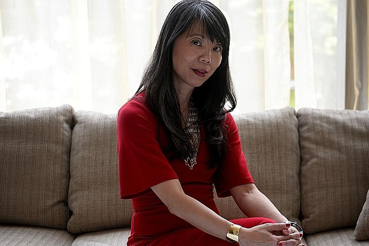 Ms JuE Wong (above) credits strong family support for her successful career.