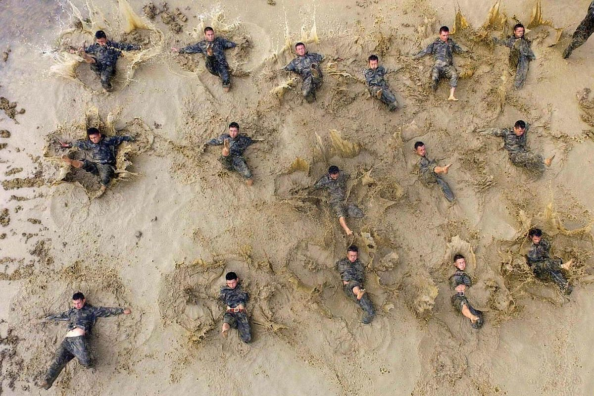 Paramilitary policemen taking part in a drill in Baise, Guangxi Zhuang Autonomous Region, China, on Sept 18, 2016.