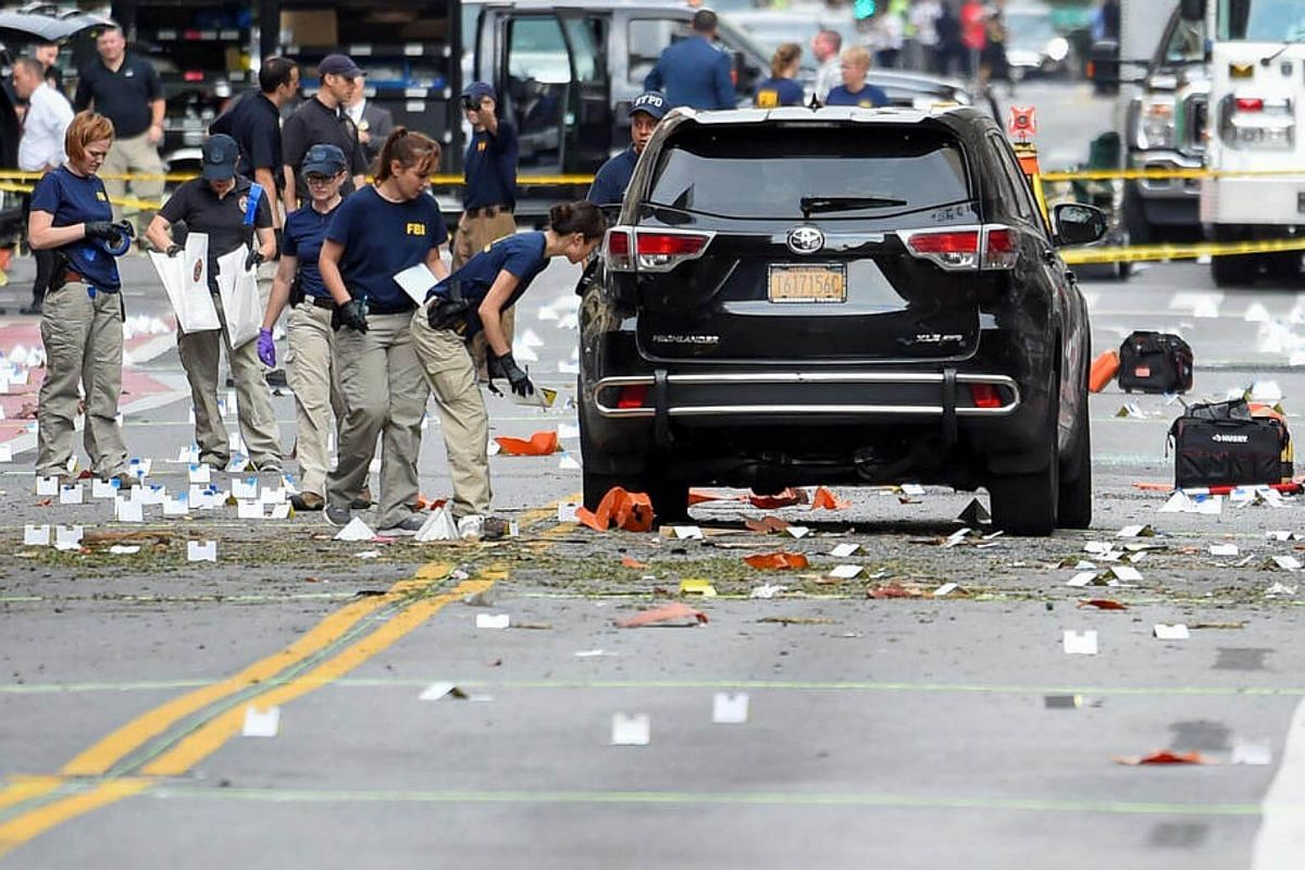 Federal Bureau of Investigation (FBI) officials label and collect evidence near the site of an explosion which took place on Saturday night in the Chelsea neighbourhood of Manhattan, New York, US on Sept 18, 2016.