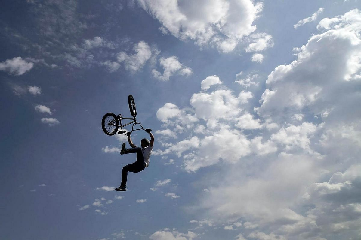 A BMX rider performing in the air at the City Day celebrations in Almaty, Kazakhstan, on Sept 18, 2016.