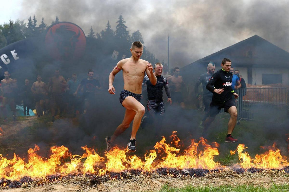 "Participants taking part in an extreme run ""Bison race"" near the town of Logoisk, Belarus on Sept 17, 2016."