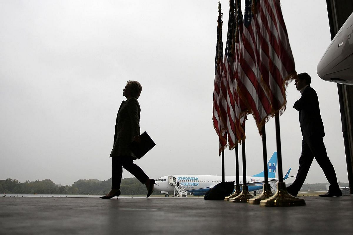 US Democratic presidential candidate Hillary Clinton arrives to a press briefing before boarding her campaign plane at the Westchester County airport in White Plains, New York on Sept 19, 2016.