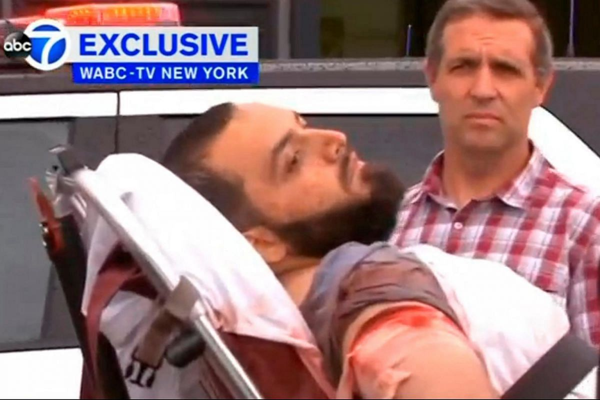 A conscious man believed to be New York bombing suspect Ahmad Khan Rahami being loaded into an ambulance after a shoot-out with police in Linden, New Jersey on Sept 19, 2016.