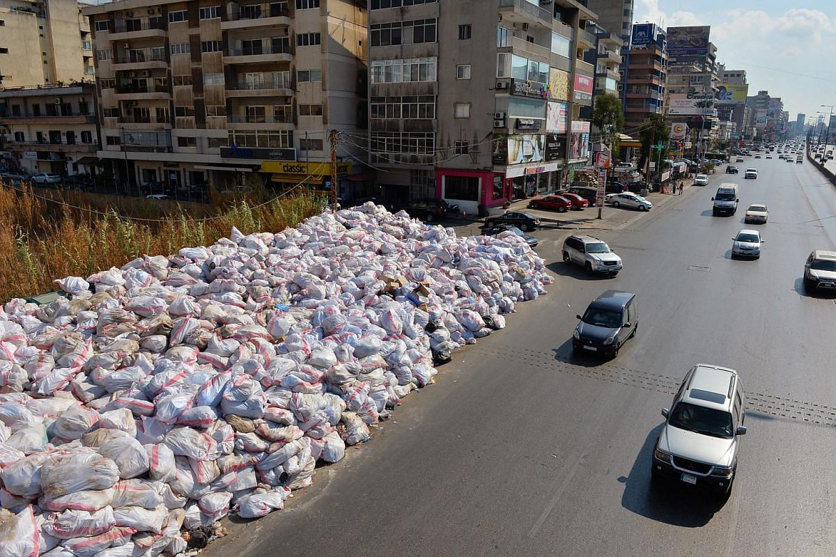 Cars driving past a pile of garbage on a highway of Jal el-Dib area, east Beirut, Lebanon on Sept 17, 2016.