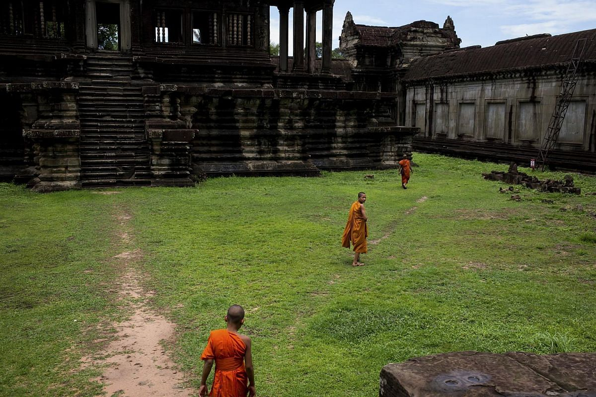 Monks inside the Angkor Wat temple complex, in Siem Reap, Cambodia on June 21, 2016. A laser technology known as lidar is pointing to mounds of evidence of an ancient kingdom that once eluded archaeologists and that once covered a vast region of what