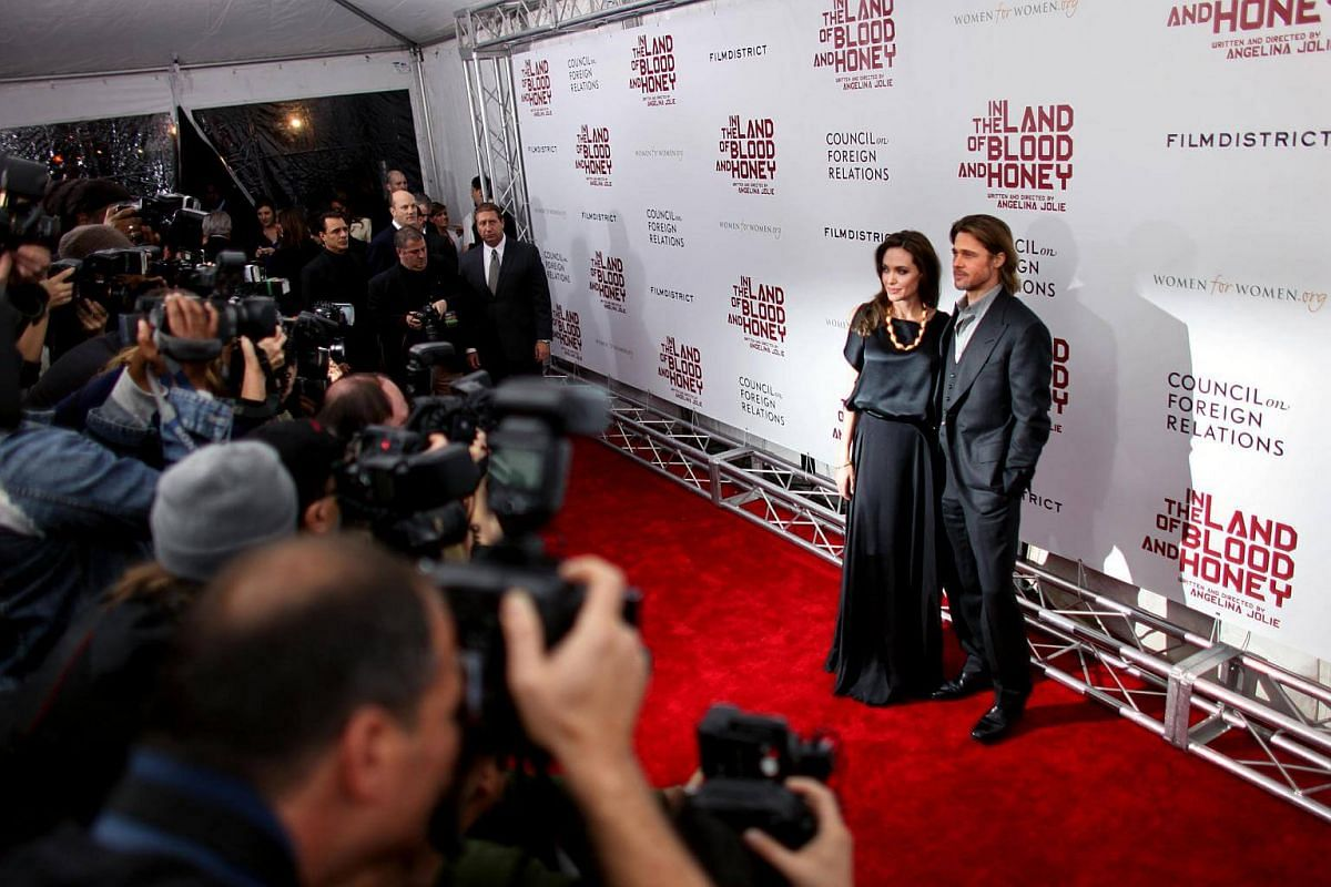 Angelina Jolie and Brad Pitt at the premiere of In The Land Of Blood And Honey, her directorial debut, in New York, on Dec 5, 2011.
