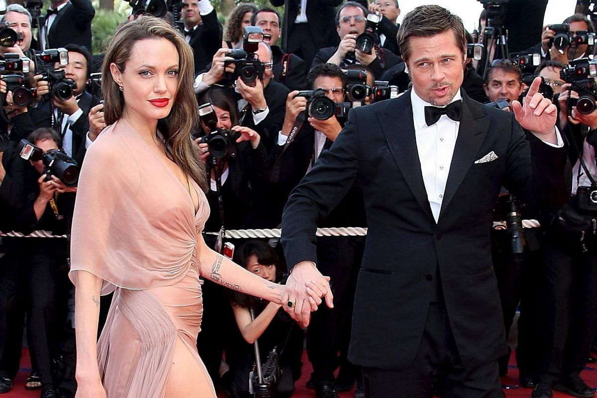 Brad Pitt (right) and Angelina Jolie (left) arriving for the gala screening of the film Inglourious Basterds at the 62nd edition of the Cannes film festival in Cannes, France, on May 20, 2009.