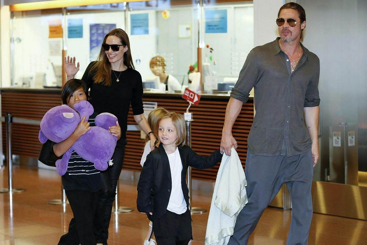 Angelina Jolie and Brad Pitt arriving with their children Pax Thien (left), Shiloh (hidden) and Knox Jolie-Pitt at the Tokyo International Airport, on July 28, 2013.