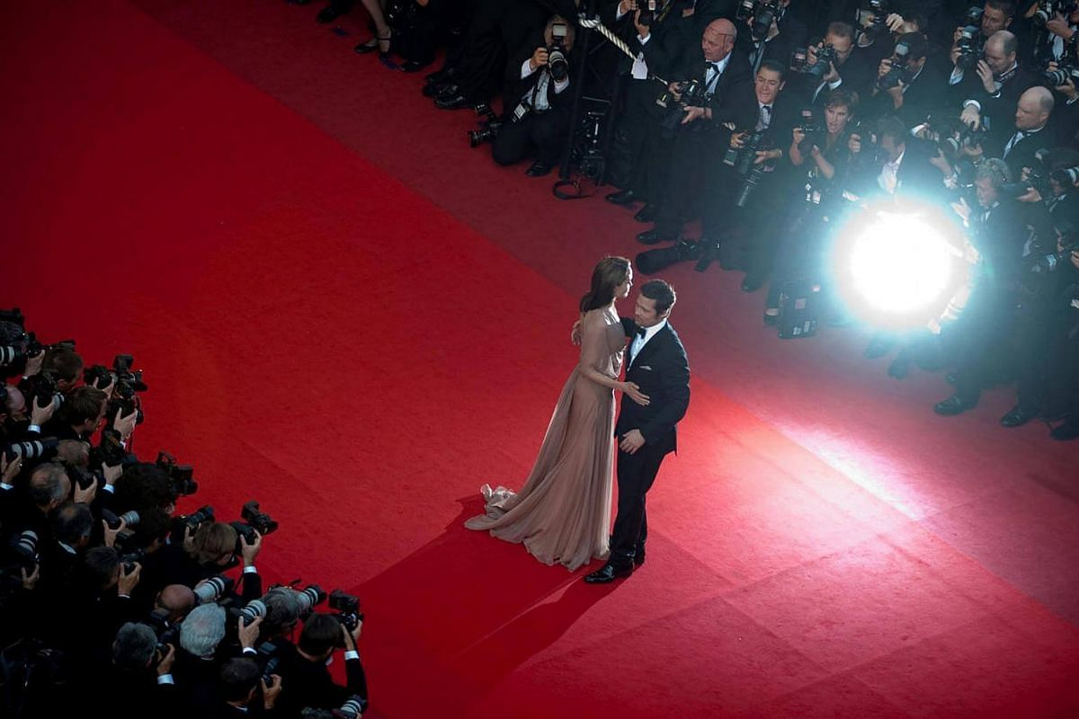 Brad Pitt and Angelina Jolie arrive on the red carpet for the screening of the film Inglourious Basterds at the 62nd Cannes Film Festival, on May 20, 2009.