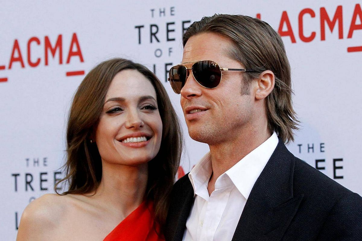 Angelina Jolie and Brad Pitt pose at the premiere of The Tree Of Life at LACMA in Los Angeles, on May 24, 2011.