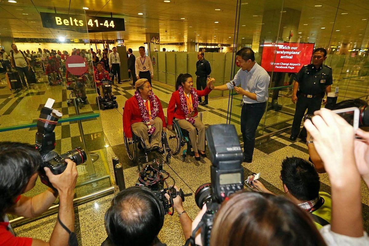 Singapore's Paralympians including Theresa Goh and Yip Pin Xiu were welcomed by Minister for Social and Family Development Tan Chuan-Jin, family, friends, supporters and sports officials at Changi Airport.