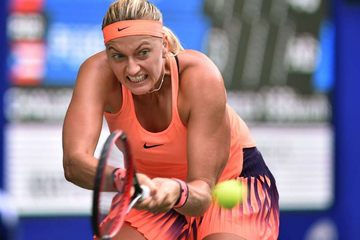 Petra Kvitova of the Czech Republic hits a return against Monica Puig of Puerto Rico during their second round match at the Toray Pan Pacific Open tennis tournament in Tokyo on Sept 21, 2016.