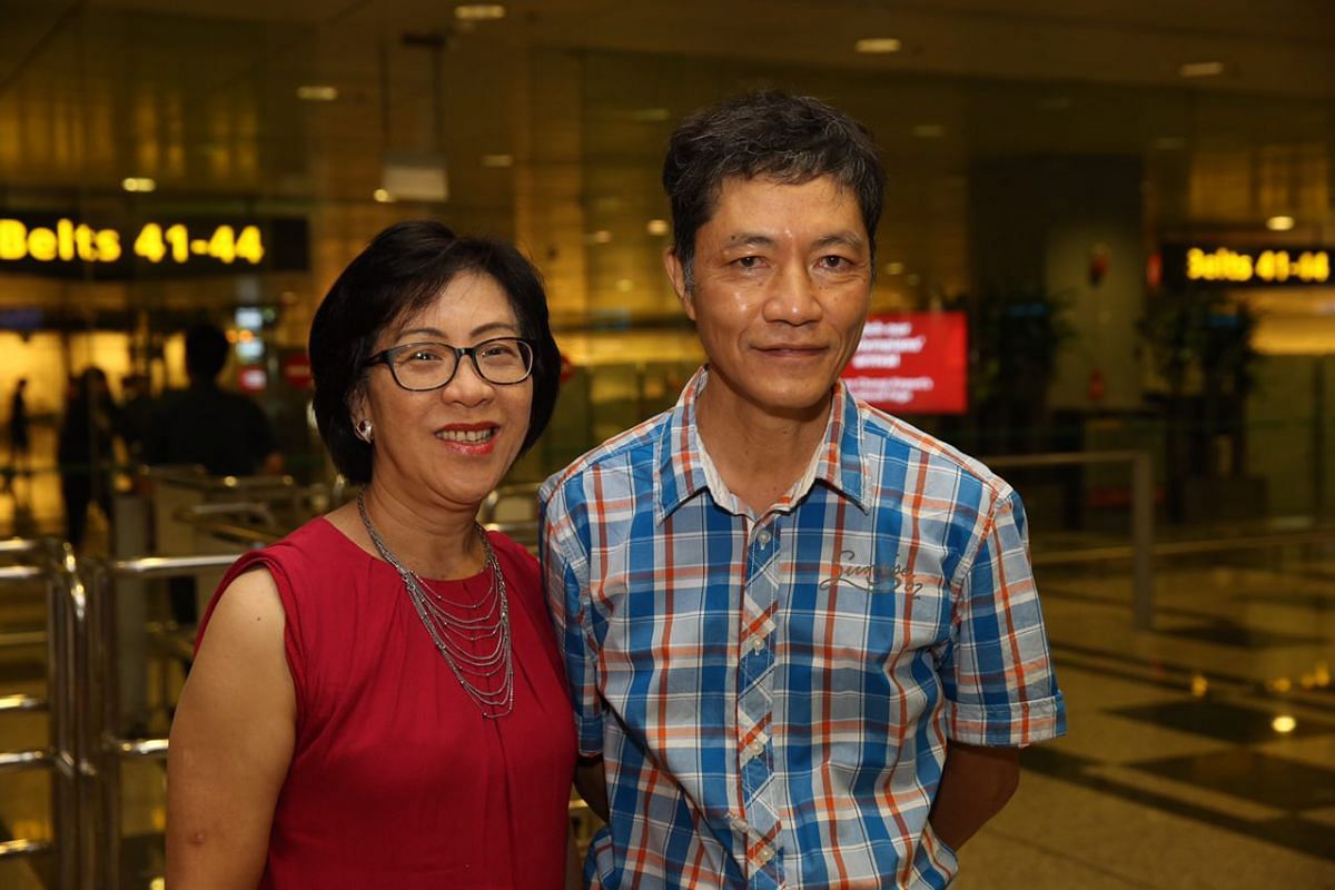 Yip Pin Xiu's parents, Mrs Margaret Yip and Mr Yip Chee Khiong, at Changi Airport to welcome their daughter home.