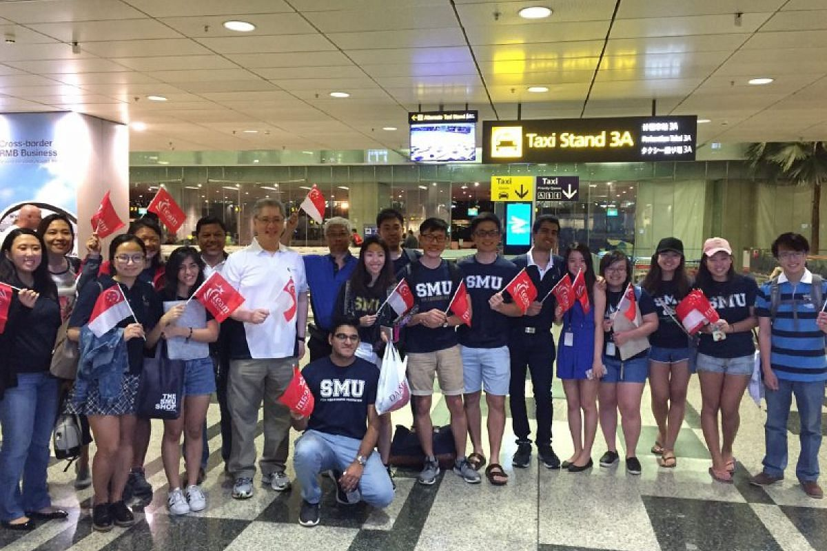 Student leaders and staff from Singapore Management University were at Changi Airport to support Yip Pin Xiu and Nurulasyiqah Taha.
