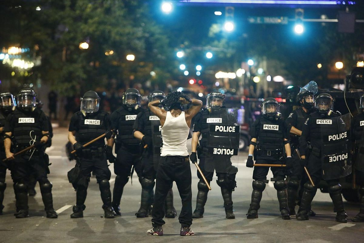 Police clash with protestors as residents and activists protest the death of Keith Scott on Sept 21, 2016 in Charlotte, North Carolina.