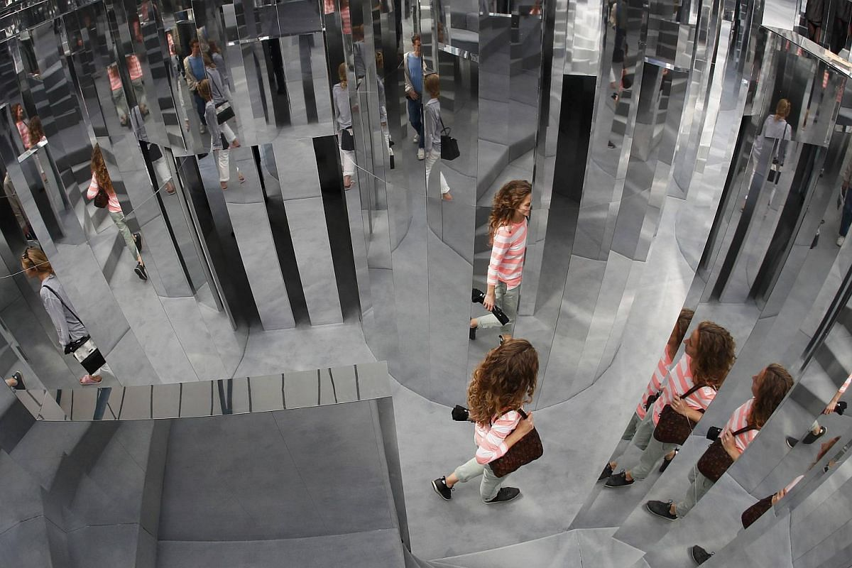 Visitors are reflected in the installation Mirror Maze by artist Es Devlin, at the Copeland Park in Peckham, south London, Britain on Sept 21, 2016.