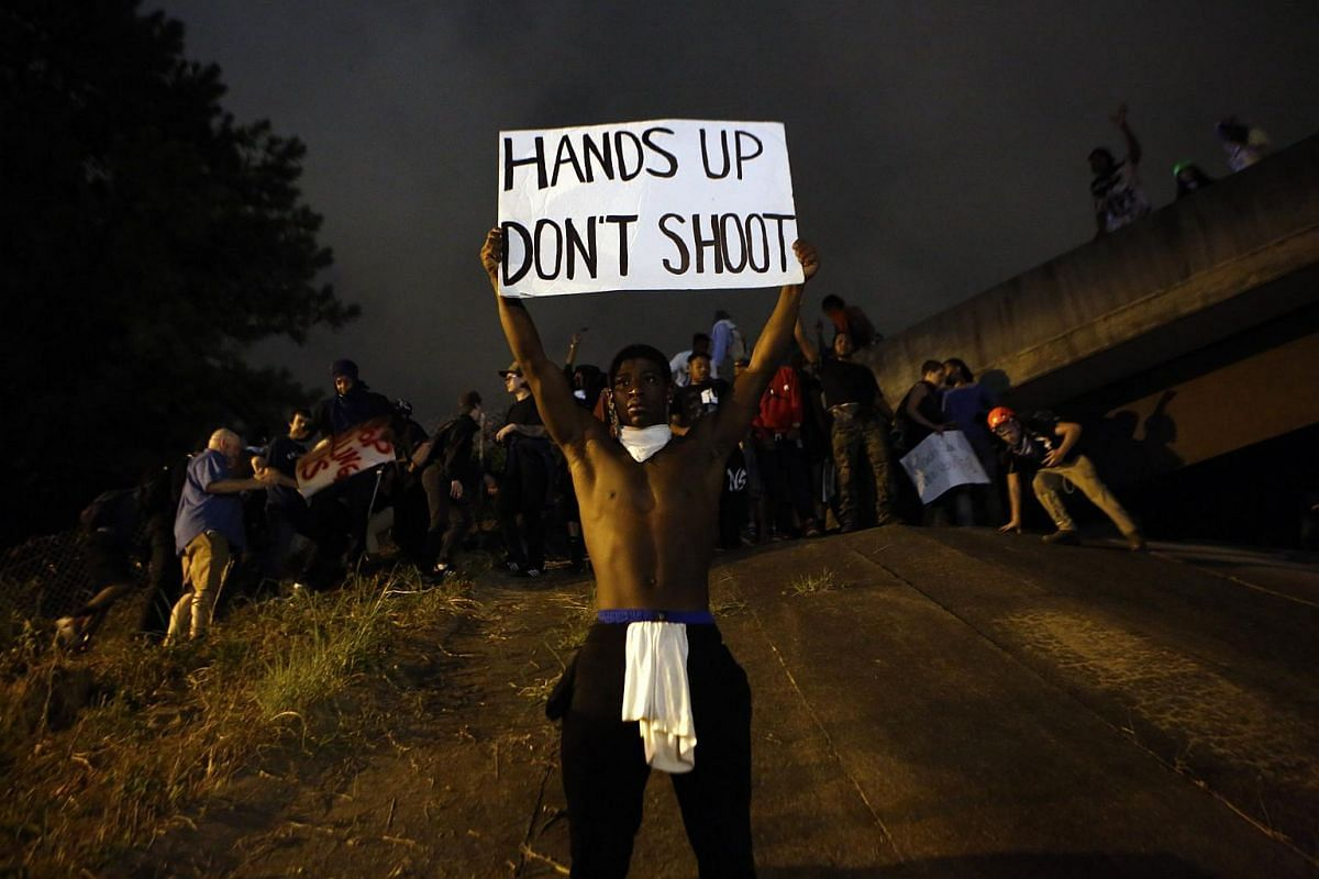Activists attempt to make their way onto Interstate 277 to block traffic as they march in the streets amid a heavy police and National Guard presence as they protest the death of Keith Scott on Sept 22, 2016 in Charlotte, North Carolina.