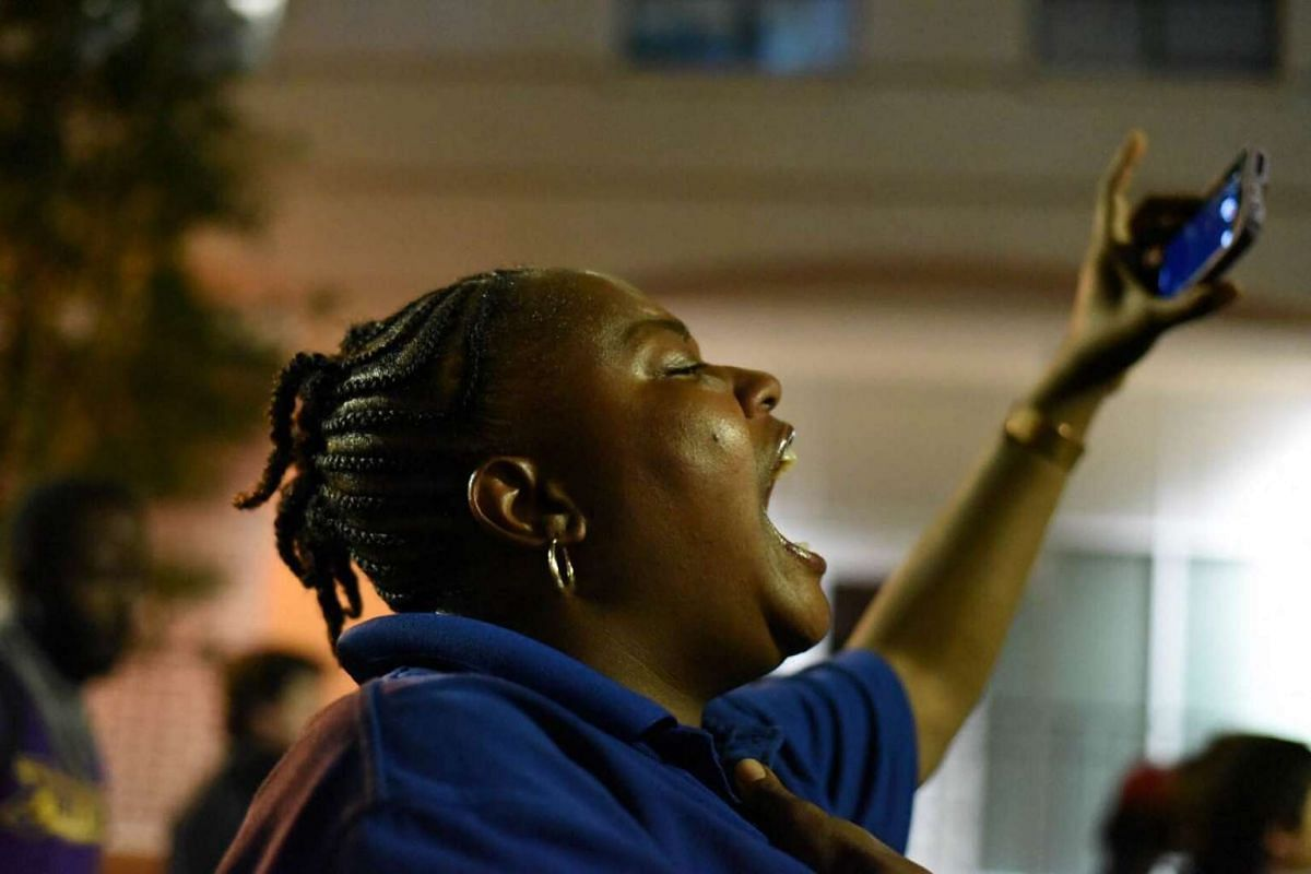 Protesters shout slogans as residents and activists protest the death of Keith Scott on Sept 22, 2016 in Charlotte, North Carolina.