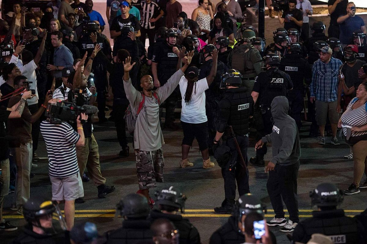 Protesters face riot police  as residents and activists protest the death of Keith Scott on Sept 21, 2016 in Charlotte, North Carolina.
