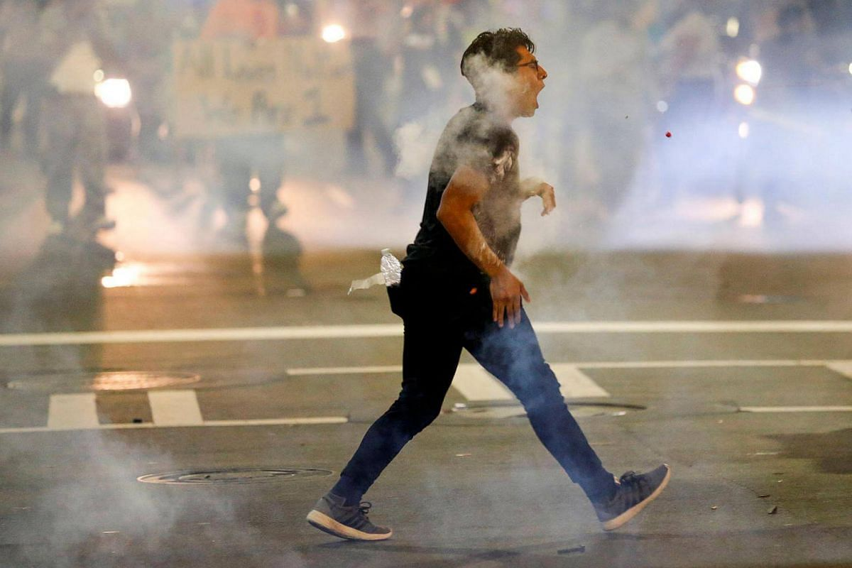 A man is hit with pepper spray paint balls as residents and activists protest the death of Keith Scott on Sept 21, 2016 in Charlotte, North Carolina.