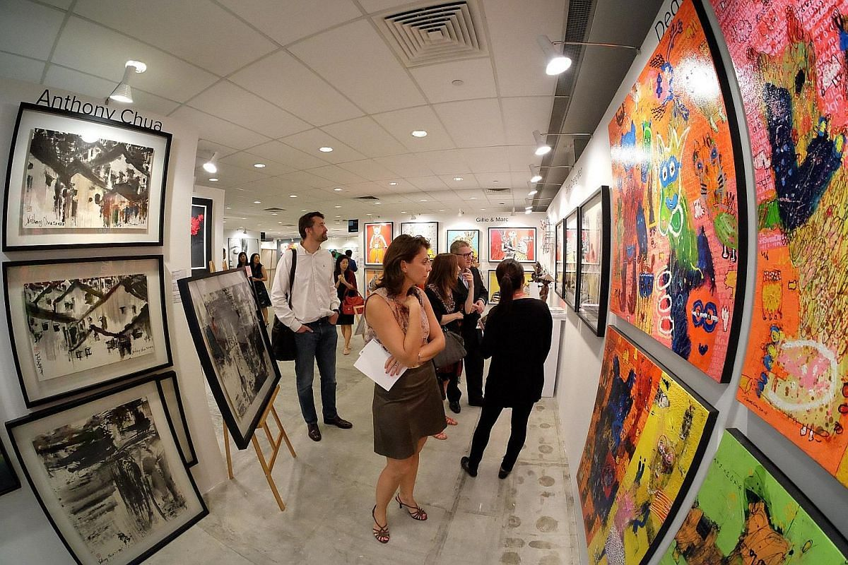Visitors at the Affordable Art Fair Singapore. Declining prices and an eager search for yield may make the art market attractive to some investors.