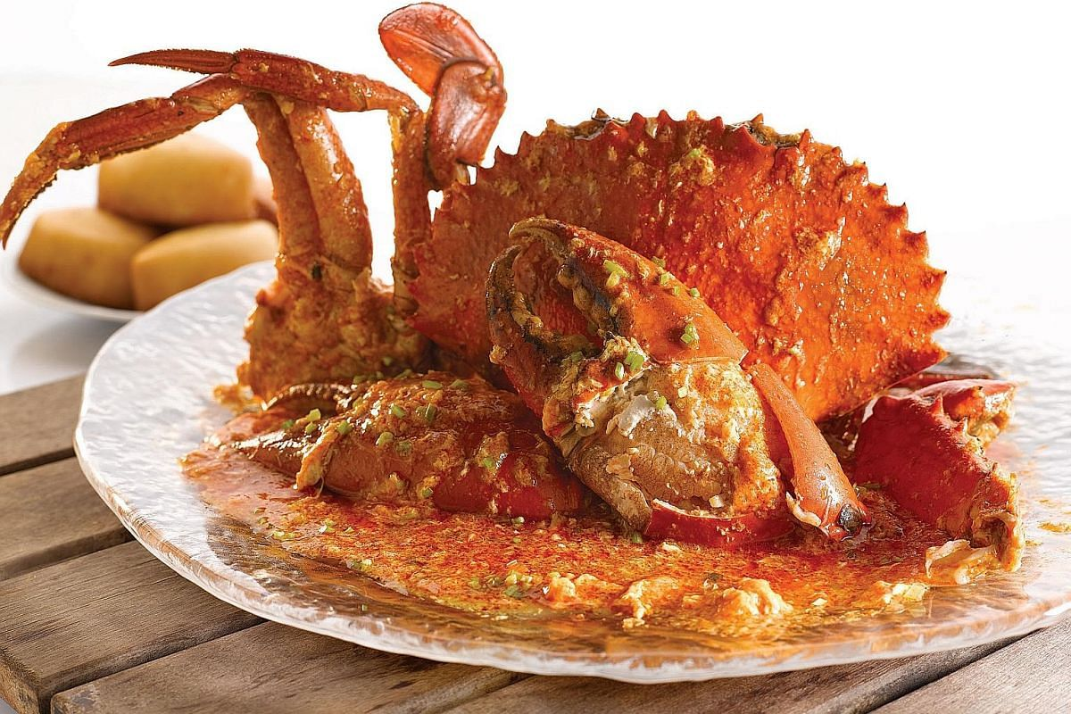 Seafood Paradise's chilli crab (above) comes with an aromatic gravy that is so good, you can eat it on its own; and geoduck fried with qinglong vegetable (left).