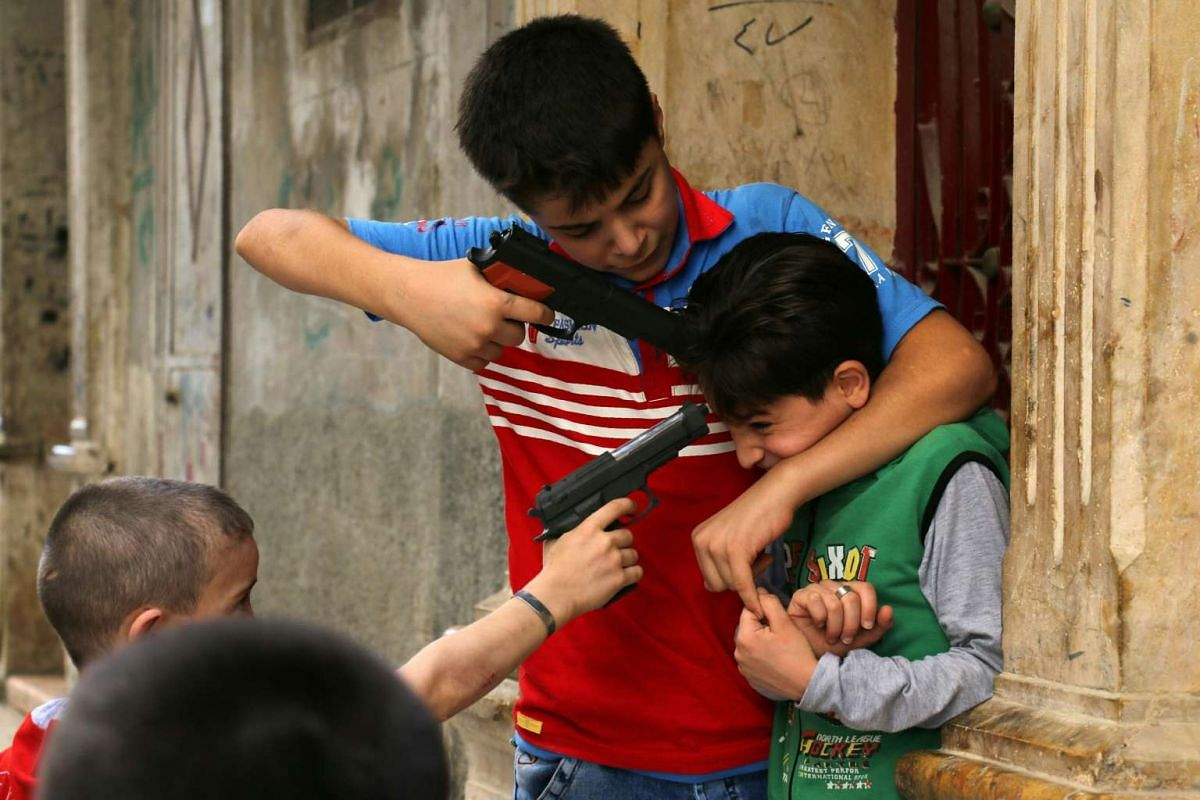 Syrian children play with plastic toys guns in a rebel-held district of the northern city of Aleppo on July 6 during celebrations for Eid al-Fitr, which marks the end of the Muslim holy fasting month of Ramadan.
