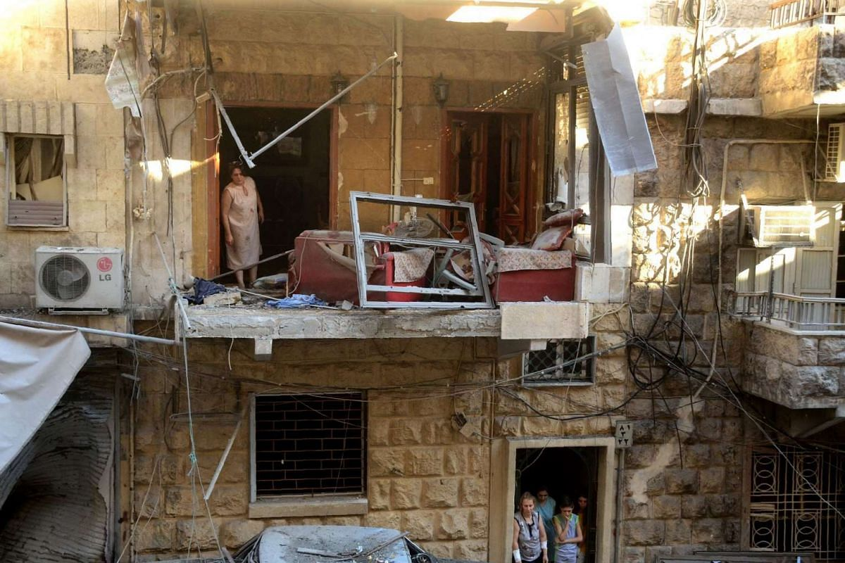 A damaged street in the ancient Syriac Quarter in the regime-held area of the northern Syrian city of Aleppo following rocket attacks by rebels on July 11.
