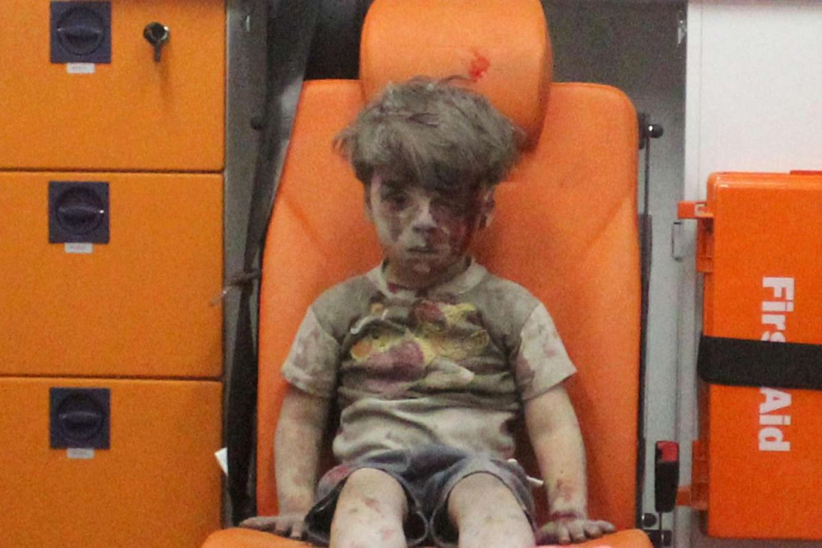 Five-year-old Omran Daqneesh, with a bloodied face, sits inside an ambulance after he was rescued following an air strike in the rebel-held al-Qaterji neighbourhood of Aleppo on Aug 17.