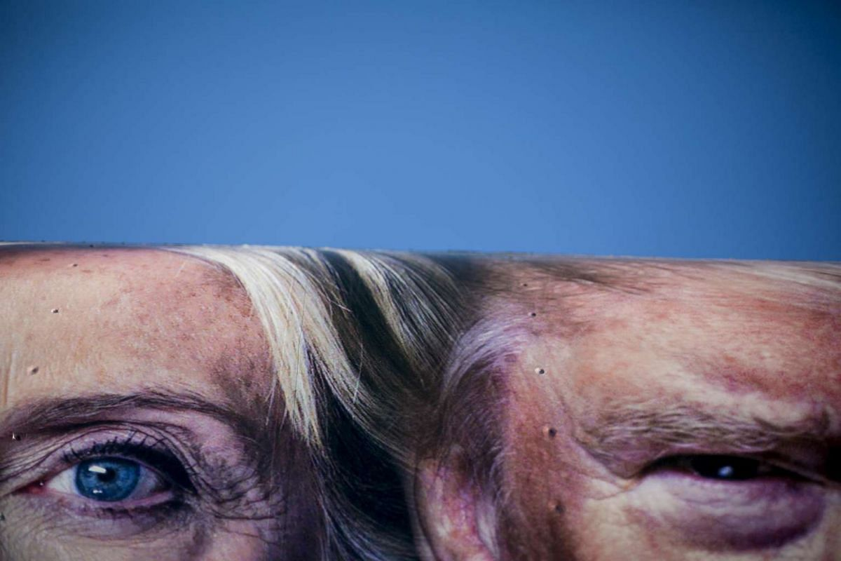 Extreme close-up images of presidential candidates Hillary Clinton and Donald Trump on the side of a CNN truck parked outside the venue for their Monday night debate, at Hofstra University in Hempstead.