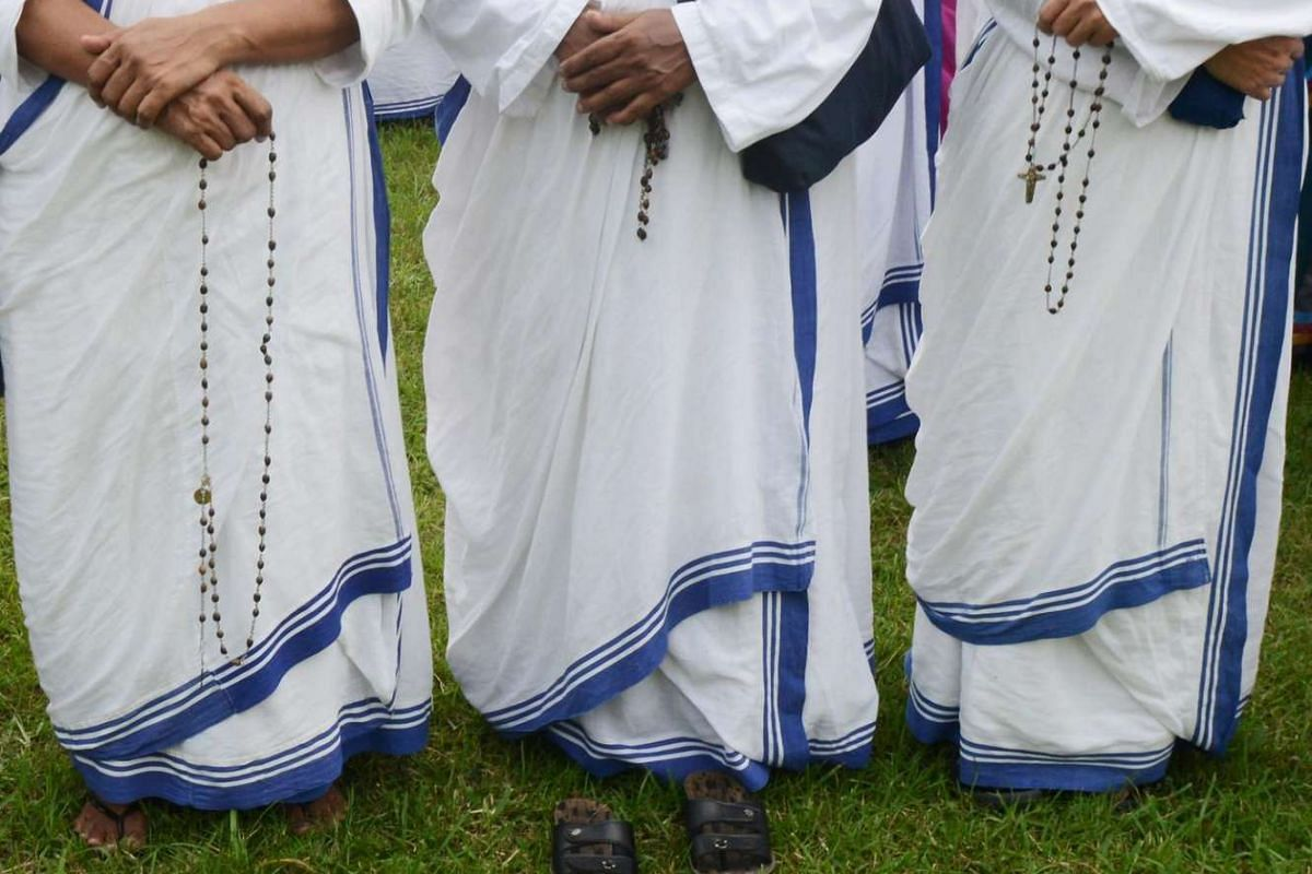Indian Roman Catholic nuns from the Missionaries of Charity prepare to take part in a walk to commemorate the life of Saint Teresa of Kolkata in Kolkata on Sept 25, 2016.
