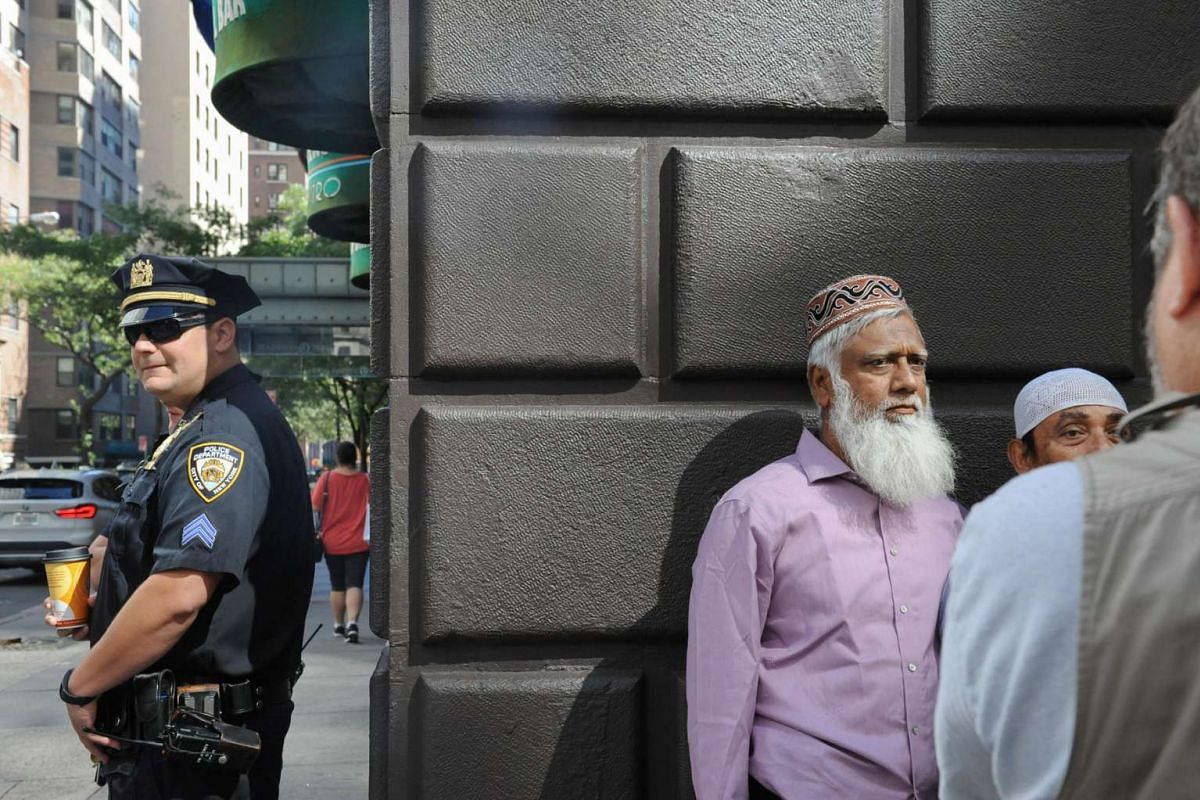 A member of the New York City police stands guard before the start of the annual Muslim Day Parade in the Manhattan borough of New York City.
