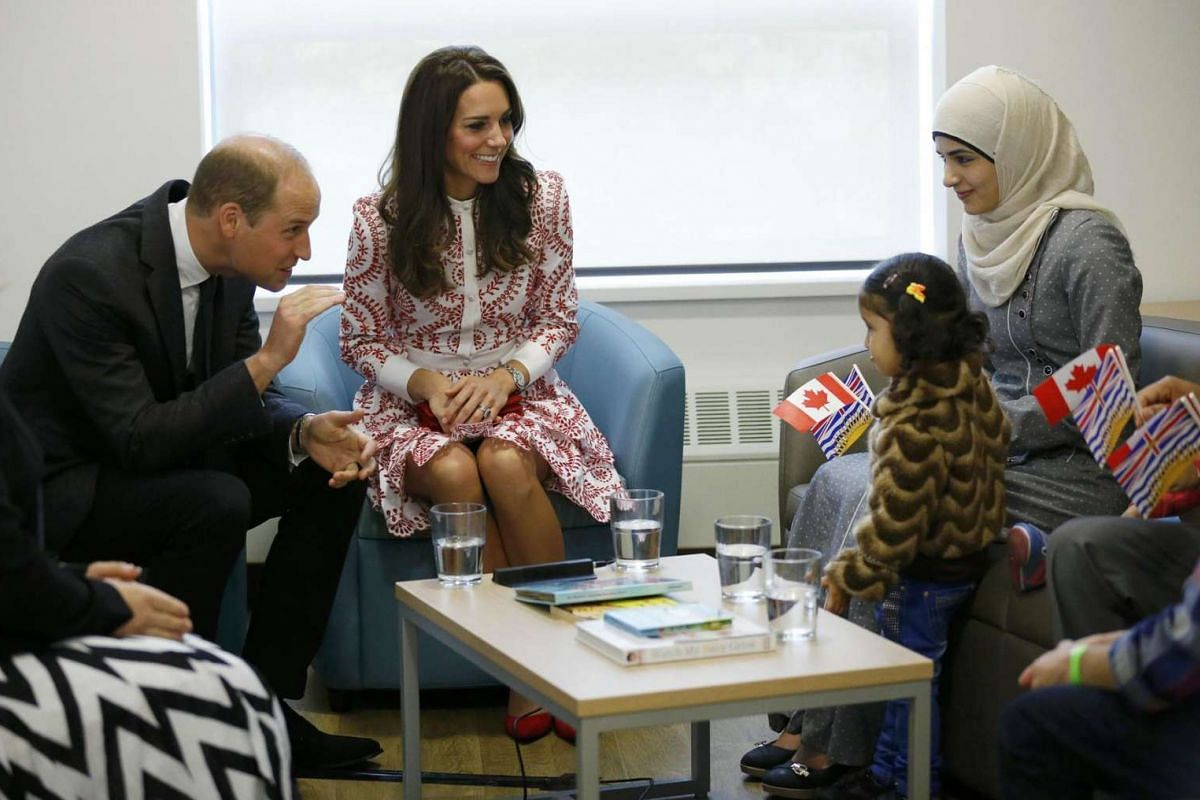 Britain's Prince William and Catherine, Duchess of Cambridge, meet with a family from Syria during a visit to the Immigrant Services Society in Vancouver.