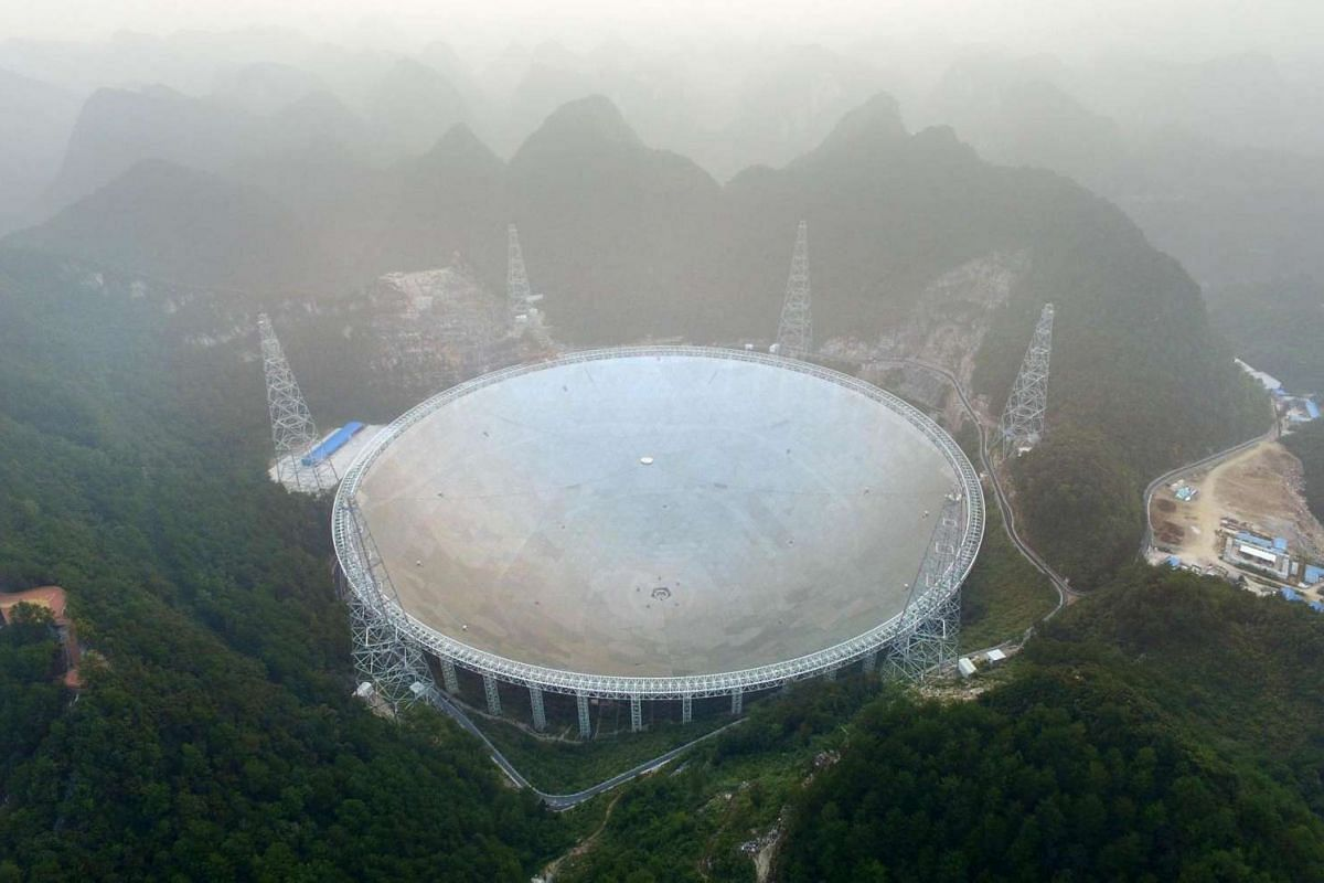 The Five-hundred-metre Aperture Spherical Radio Telescope (FAST) is seen on its first day of operation in Pingtang, in southwestern China's Guizhou province on Sept 25, 2016.
