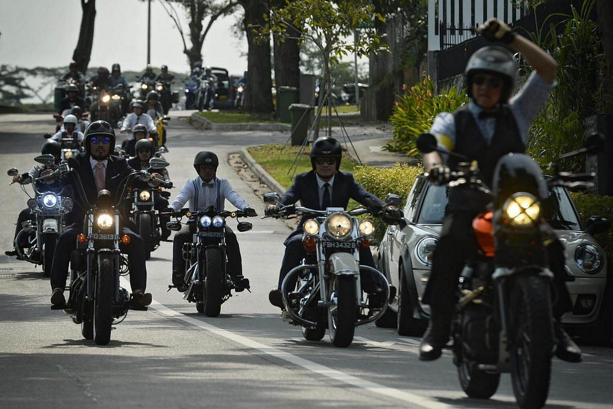 Participants of the 2016 Distinguished Gentlemen's Ride pass through South Buona Vista Road on Sept 25, 2016.