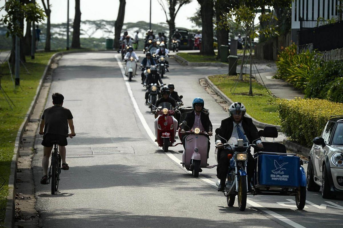 Participants of the 2016 Distinguished Gentlemen's Ride pass through Old Holland Road on Sept 25, 2016.