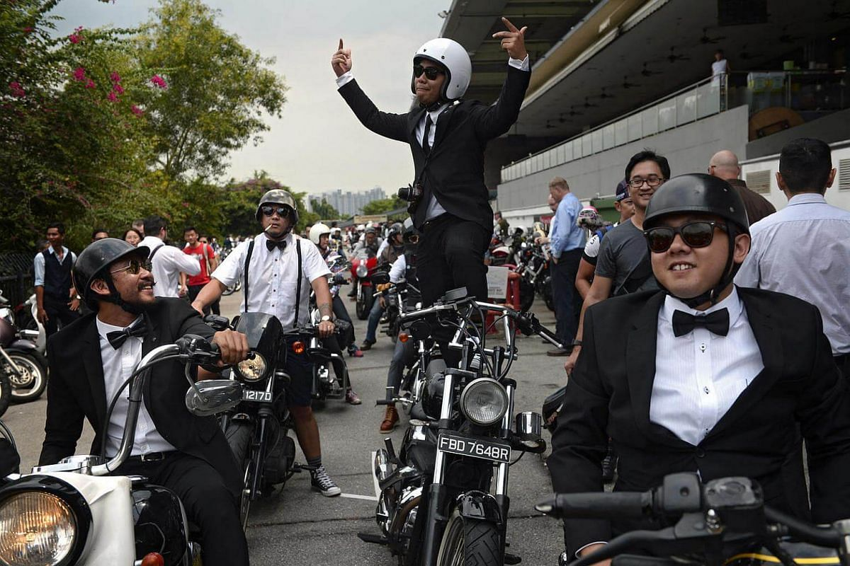 A participant of the 2016 Distinguished Gentlemen's Ride poses for a photo at Turf City on Sept 25, 2016.