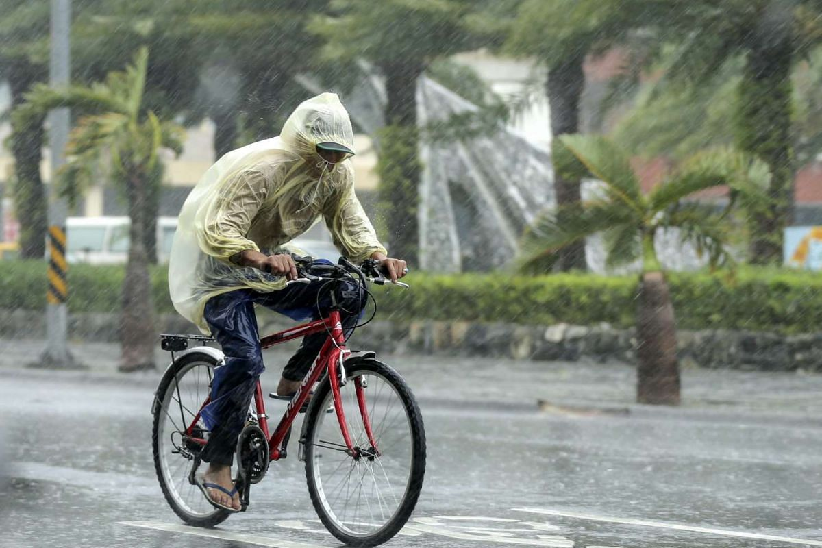 A man braves to heavy rains as typhoon Megi hits Hualien county, eastern Taiwan on Sept 27, 2016.