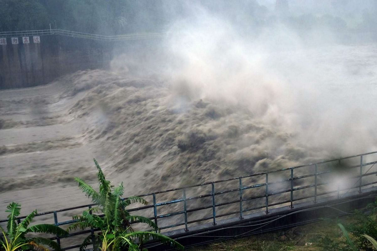 Churning waters in the Jhihtan Dam is seen in Xindian district, New Taipei City, as Typhoon Megi hit eastern Taiwan  on Sept 27, 2016.
