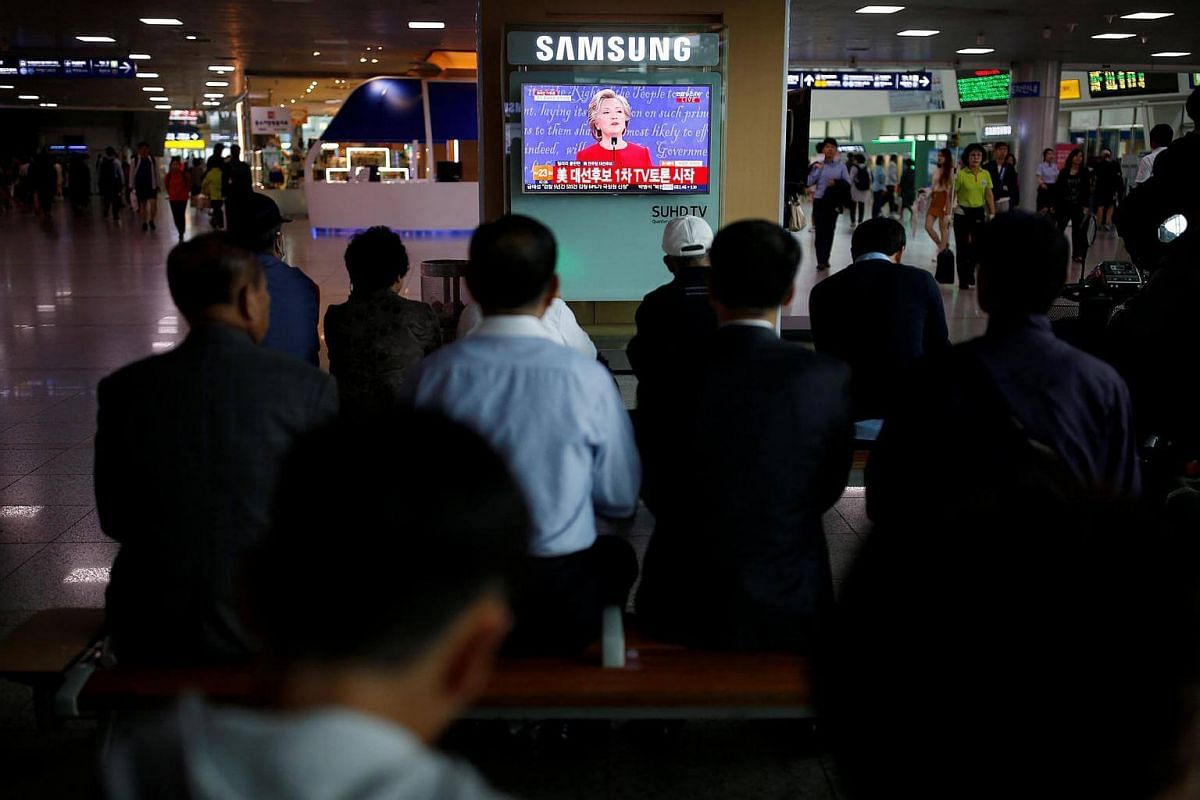 People in Seoul, South Korea, watching a TV broadcast of the first presidential debate between US Democratic candidate Hillary Clinton and Republican nominee Donald Trump on Sept 27, 2016.
