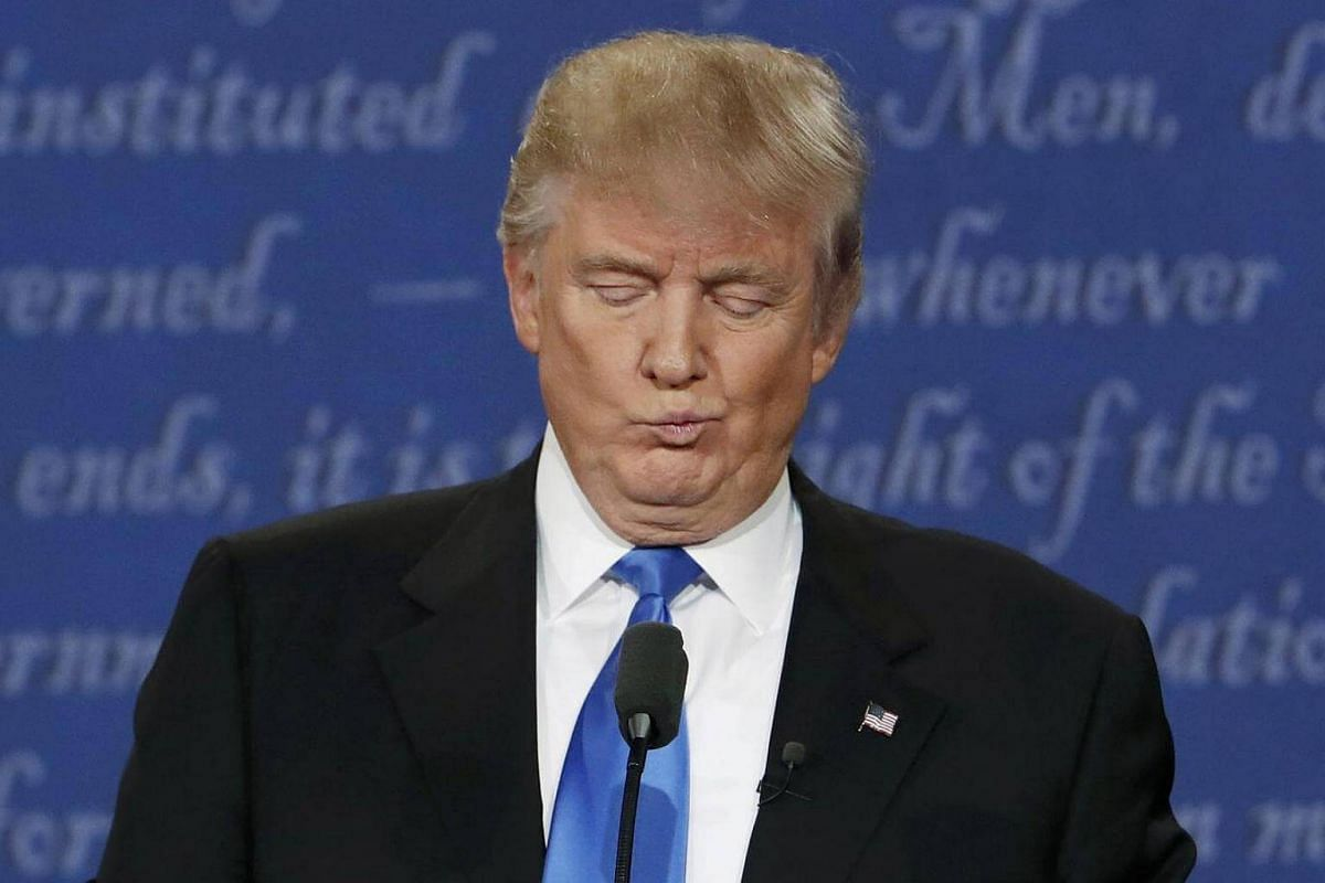 Republican nominee Donald Trump reacts during the first presidential debate with Democratic candidate Hillary Clinton at Hofstra University in Hempstead, New York, on Sept 26, 2016.
