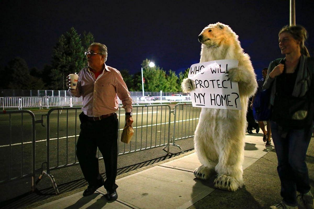 An activist dressed up as a bear walks outside Hofstra University, where the first presidential debate will take place at the David & Mack Sport and Exhibition Complex, in Hempstead, New York, on Sept 26, 2016.