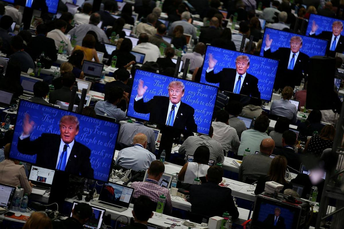 Republican presidential nominee Donald Trump is seen on television screens at the media room during the first presidential debate with Democratic candidate Hillary Clinton at Hofstra University in Hempstead, New York, on Sept 26, 2016.